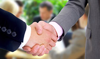 A photo of a handshake between colleagues